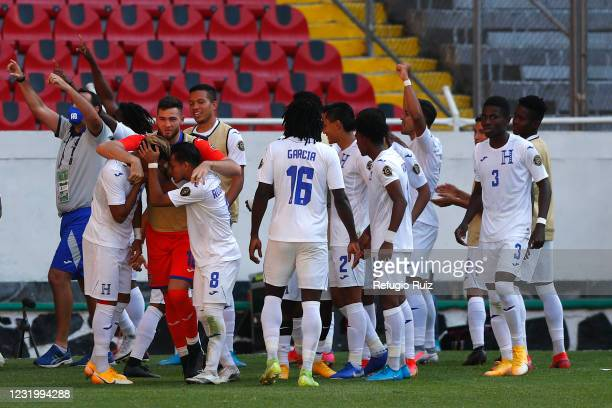 Luis Palma of Honduras celebrates with his teammates after scoring the second goal of his team during the semifinals match between Honduras and USA...