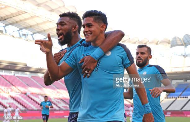 Luis Palma of Team Honduras celebrates with teammate Jorge Benguche after scoring their side's first goal during the Men's First Round Group B match...