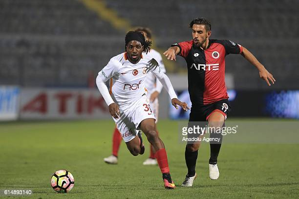 Luis Pedro Cavanda of Galatasaray in action against rfan Can Kahveci of Genclerbirligi during the Turkish Spor Toto Super Lig football match between...