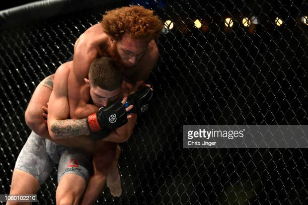 Luis Pena attempts to submit Michael Trizano in their lightweight bout during the UFC Fight Night event inside Pepsi Center on November 10 2018 in...