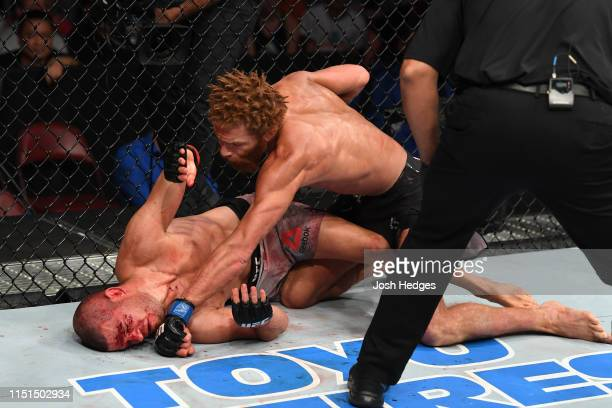 Luis Pena punches Matt Wiman in their lightweight bout during the UFC Fight Night event at Bon Secours Wellness Arena on June 22 2019 in Greenville...