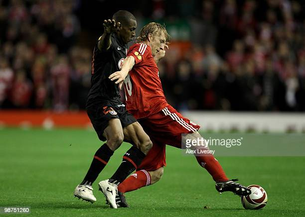 Luis Perea of Atletico Madrid battles for the ball with Dirk Kuyt of Liverpool during the UEFA Europa League SemiFinal Second Leg match between...