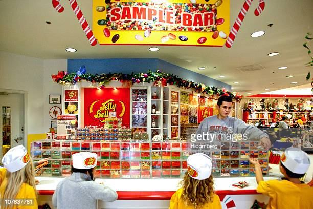 Luis Perez hands outs jelly bean samples to kids at the Jelly Belly Candy Co store next to the company's manufacturing facility in Fairfield...
