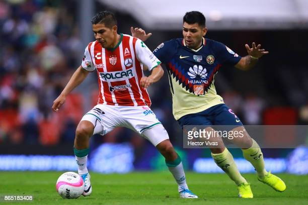 Luis Perez of Necaxa struggles for the ball with Silvio Romero of America during the 14th round match between America and Necaxa as part of the...