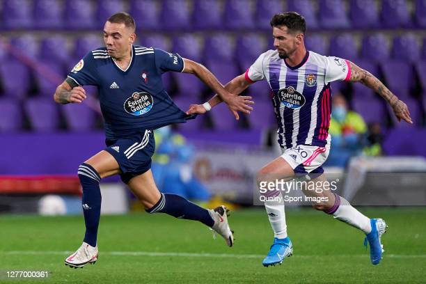 Luis Perez of Real Valladolid battle for the ball with Iago Aspas of RC Celta during the La Liga Santander match between Real Valladolid CF and RC...