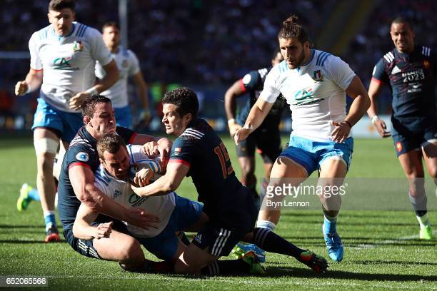 Luis Picamoles and Brice Dulin of France tackle of Giorgio Bronzini of Italy during the RBS Six Nations match between Italy and France at Stadio...