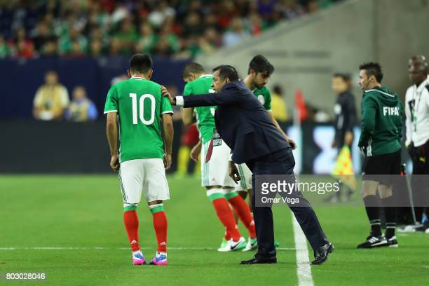 Luis Pompilio Paez coach of Mexico gives instructions to player Martin Barragan during the friendly match between Mexico and Ghana at NRG Stadium on...