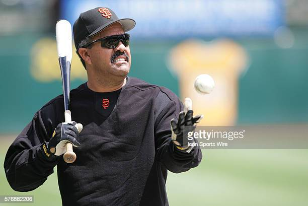 Luis Pujols Giants' first base coach is pictured during batting practice before the game against Athletics at McAfee Coliseum in Oakland California...