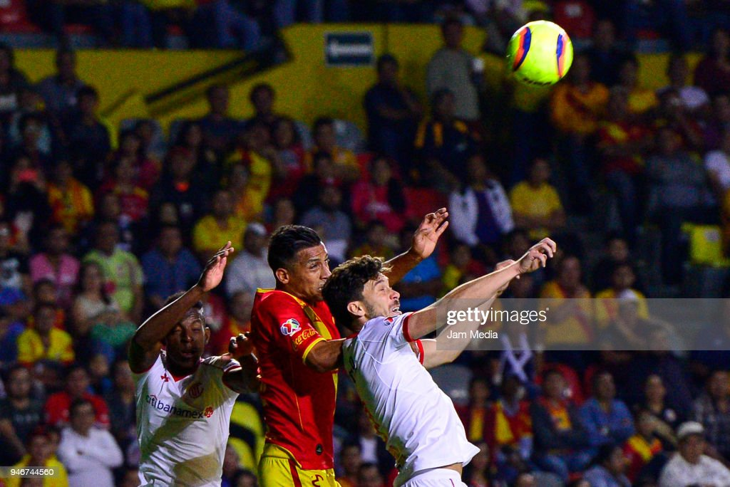 Luis Quinones (L) and Osvaldo Gonzalez (R) of Toluca jump for the ball with Angel Sepulveda (C) of Morelia during the 15th round match between Morelia and Toluca as part of the Torneo Clausura 2018 Liga MX at Jose Maria Morelos Stadium on April 14, 2018 in Morelia, Mexico.