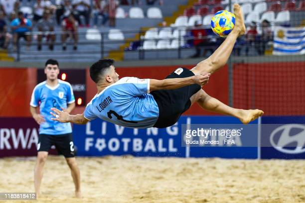 Luis Quinta of Uruguay takes an overhead kick during the FIFA Beach Soccer World Cup Paraguay 2019 group B match between Uruguay and Mexico at...