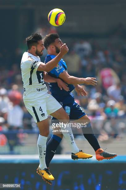 Luis Quintana of Pumas and Lucas Cavallini of Puebla fight for the ball during the 15th round match between Pumas UNAM and Puebla as part of the...