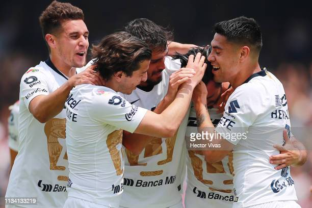 Luis Quintana of Pumas celebrates with teammates after scoring the second goal of his team during the 12th round match between Pumas UNAM and Chivas...