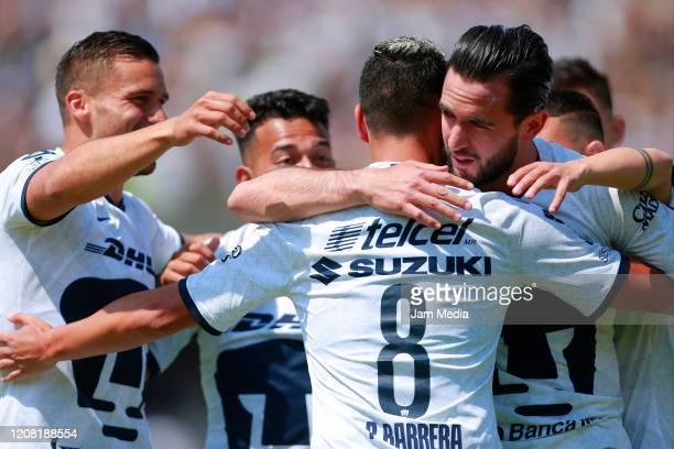 Luis Quintana of Pumas celebrates with teammates after scoring the first goal of his team during the 7th round match between Pumas UNAM and Morelia...