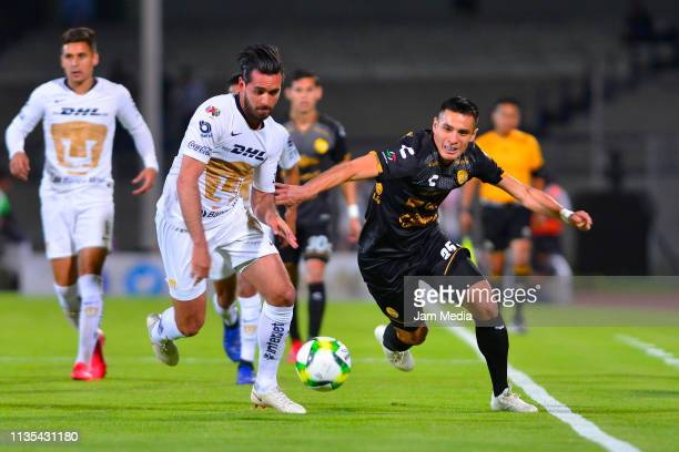 Luis Quintana of Pumas fights for the ball with Rubio Rubin of Dorados during the quarterfinals match between Pumas UNAM and Dorados as part of the...