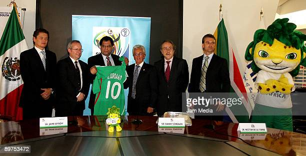 Luis Quintero, Danny Jordaan of the Local Organising Committee chief executive for the 2010 World Cup, Zakumi, Justino Compean, Jaime Bayrom, Decio...