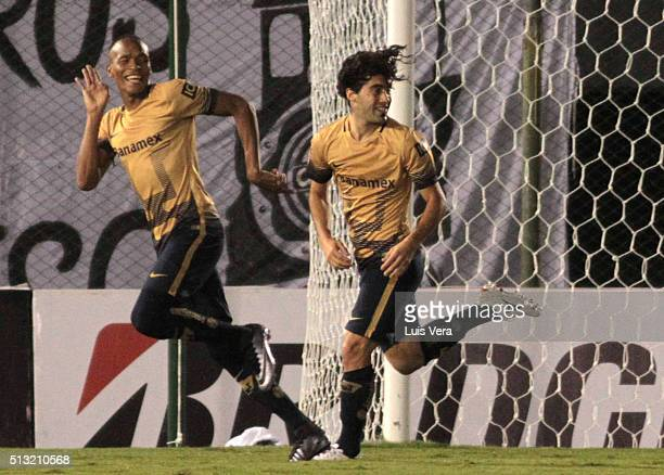 Luis Quiñones of Pumas celebrates with his teammate Matias Britos after scoring the opening goal during a match between Olimpia and Pumas UNAM as...