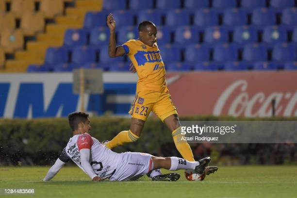 Luis Quiñones of Tigres fights for the ball with Diego Barbosa of Atlas during the 17th round match between Tigres UANL and Atlas as part of the...