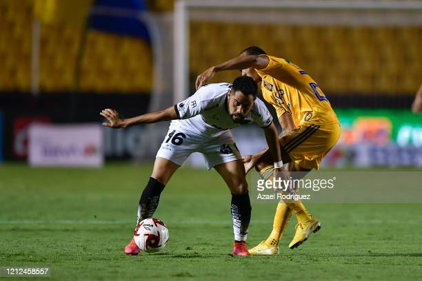 Luis Quiñones of Tigres fights for the ball with José Esquivel of Juárez during the 10th round match between Tigres UANL and FC Juarez as part of the...