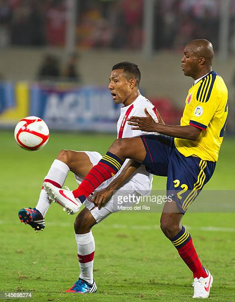 Luis Ramirez from Peru fights for the ball with Aquivaldo Mosquera from Colombia during the match between Peru and Colombia at Estadio Nacional...