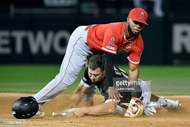 Luis Rengifo of the Los Angeles Angels of Anaheim collides with Adam Engel of the Chicago White Sox after turning a double play in the seventh inning...