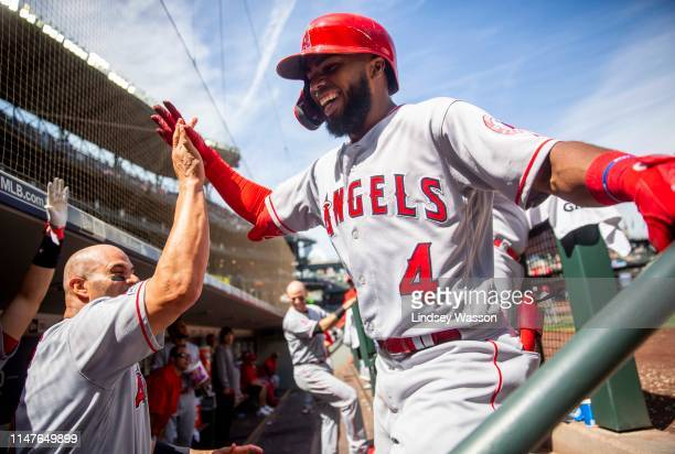 Luis Rengifo of the Los Angeles Angels of Anaheim is greeted by Albert Pujols after hitting his first career home run in the sixth inning against the...