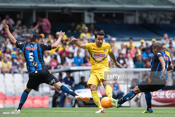 Luis Rey of America fights for the ball with Yasser Corona of Queretaro during a match between America and Queretaro as part of the 16th round...