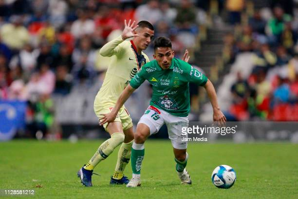 Luis Reyes of America and Angel Mena of Leon compete for the ball during the 6th round match between America and Leon as part of the Torneo Clausura...