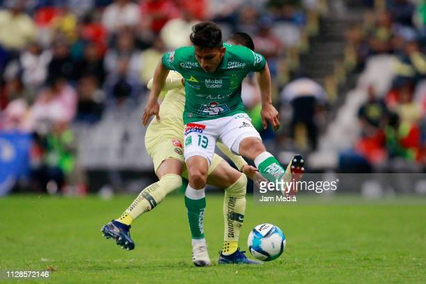 Luis Reyes of America and Angel Mena of Leon competes for the ball during the 6th round match between America and Leon as part of the Torneo Clausura...