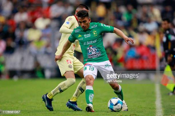 Luis Reyes of America and Angel Mena of Leon fight for the ball during the 6th round match between America and Leon as part of the Torneo Clausura...