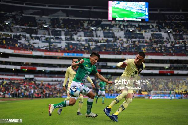 Luis Reyes of America struggles for the ball against Angel Mena of Leon during the 6th round match between America and Leon as part of the Torneo...