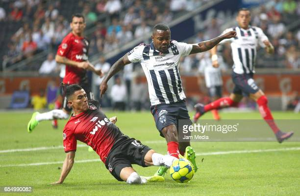 Luis Reyes of Atlas and Dorlan Pabon of Monterrey fight for the ball during the 11th round match match between Monterrey and Atlas as part of the...