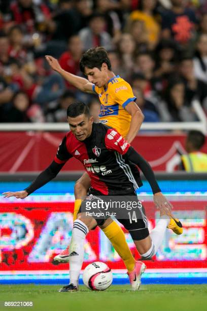Luis Reyes of Atlas fights for the ball with Jurgen Damm of Tigres during the 8th round match between Atlas and Tigres UANL as part of the Torneo...