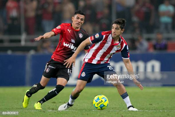 Luis Reyes of Atlas fights for the ball with Rodolfo Pizarro of Chivas during the 6th round match between Atlas and Chivas as part of the Torneo...