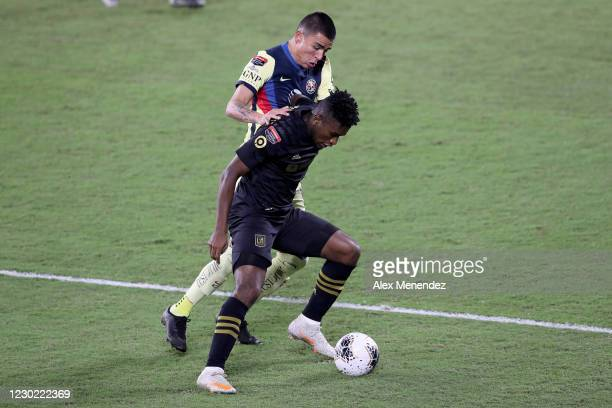 Luis Reyes of Club America fouls Jose Cifuentes of Los Angeles FC during the CONCACAF Champions League semifinal game at Exploria Stadium on December...