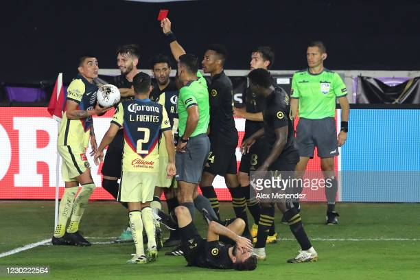 Luis Reyes of Club America is issued a red card after fouling Diego Rossi of Los Angeles FC during the CONCACAF Champions League semifinal game at...