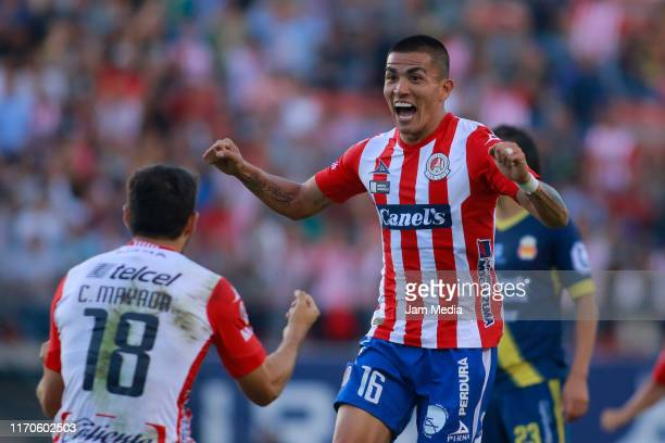 Luis Reyes of San Luis celebrates with teammate after scoring the first goal of his team during the 7th round match between Atletico San Luis and...