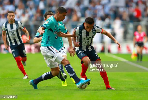 Luis Reyes of San Luis fights for the ball with Carlos Rodriguez of Monterrey during the 9th round match between Monterrey and Atletico San Luis as...