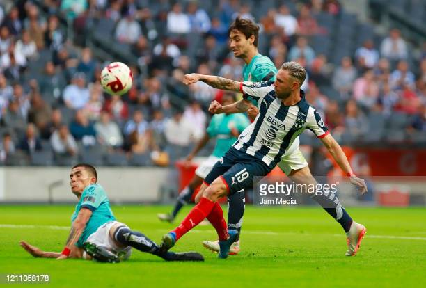 Luis Reyes of San Luis fights for the ball with Miguel Layun of Monterrey during the 9th round match between Monterrey and Atletico San Luis as part...