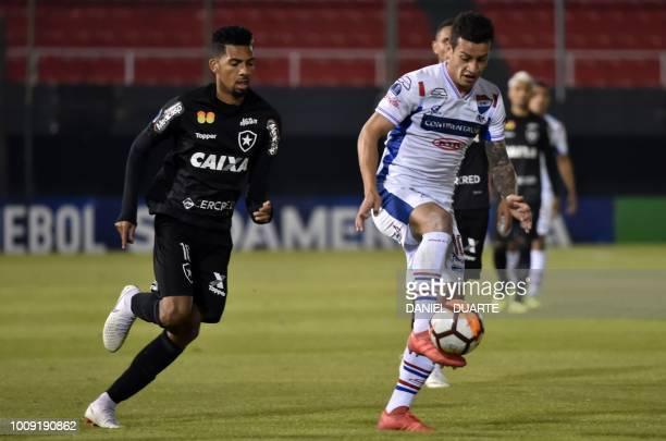 Luis Ricardo of Brazils Botafogo vies for the ball with Juan Santacruz of Paraguay's Nacional during a 2018 Copa Sudamericana football match at...