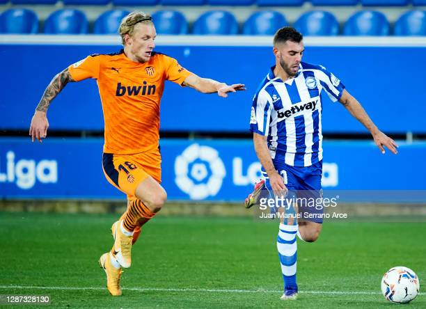 Luis Rioja of Deportivo Alaves duels for the ball with Daniel Wass of Valencia CF during the LaLiga Santander match between Alaves and Valencia on...