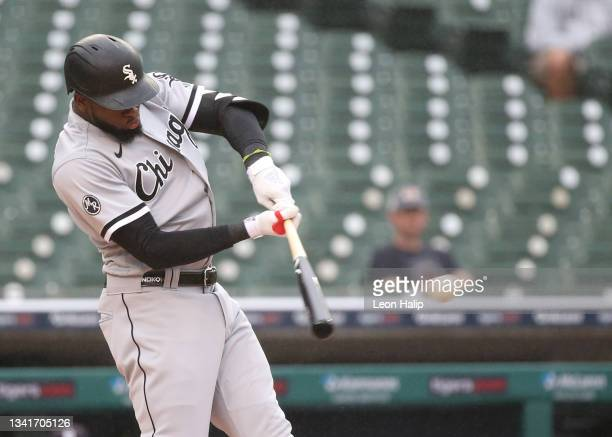 Luis Robert of the Chicago White Sox doubles to center field during the first inning of the game against the Detroit Tigers at Comerica Park on...