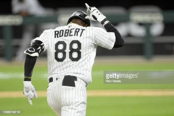 Luis Robert of the Chicago White Sox reacts after hitting the second of his two home runs on the night in the eighth inning off of Kyle Funkhouser of...