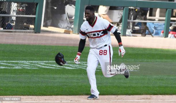 Luis Robert of the Chicago White Sox throws his helmet after hitting a walk off three run home run against the Kansas City Royals during the tenth...