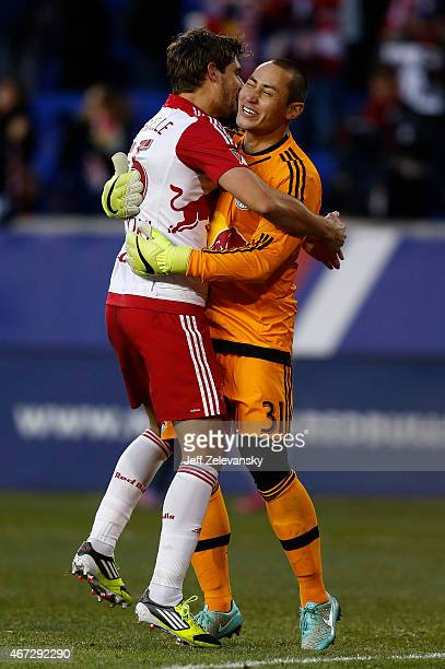 Luis Robles and Damien Perrinelle of New York Red Bulls celebrate a victory over DC United at Red Bull Arena on March 22 2015 in Harrison New Jersey