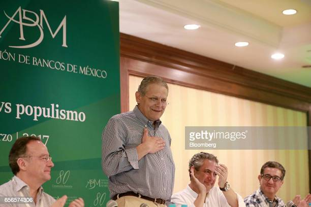 Luis Robles Miaja chairman of BBVA Bancomer SA and president of the Mexican Banking Association second left speaks as Alberto Gomez Alcala executive...