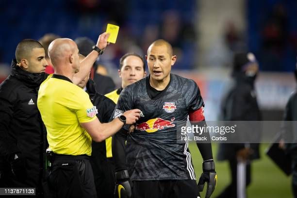 Luis Robles of New York Red Bulls gets a yellow card for having words with the referees after the match between Orlando City SC and New York Red...