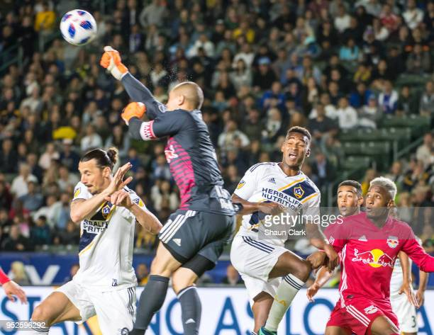 Luis Robles of New York Red Bulls punches the ball away as Zlatan Ibrahimovic of Los Angeles Galaxy tries to get on the end of a cross during the Los...
