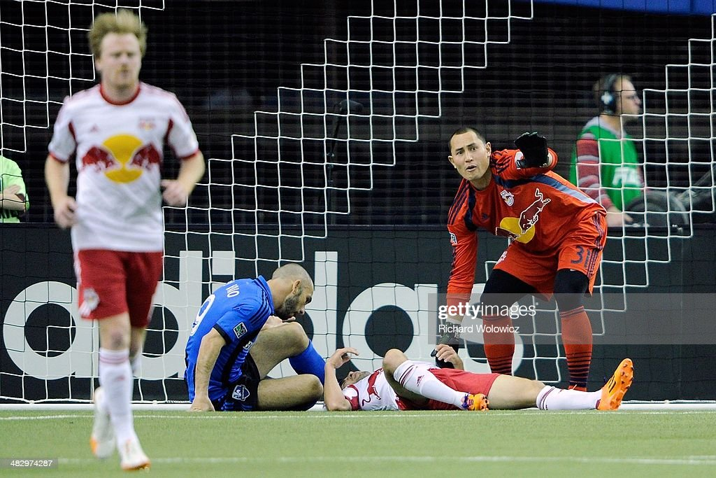 Luis Robles #31 of the New York RedBulls calls for help from the bench for fallen teammate Kosuke Kimura #27 during the MLS game against the Montreal Impact at the Olympic Stadium on April 5, 2014 in Montreal, Quebec, Canada.