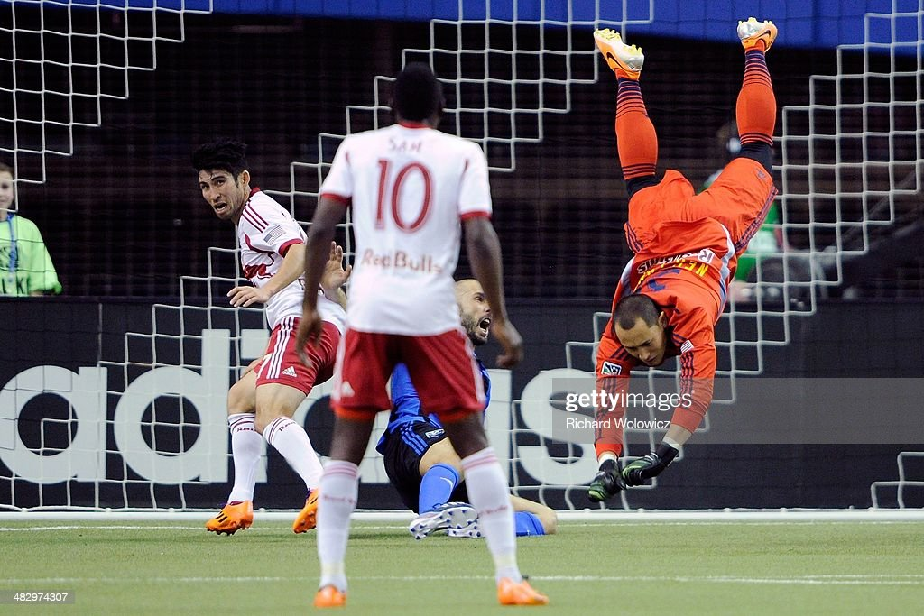 Luis Robles #31 of the New York RedBulls in midair after colliding with Marco Di Vaio #9 of the Montreal Impact during the MLS game at the Olympic Stadium on April 5, 2014 in Montreal, Quebec, Canada.