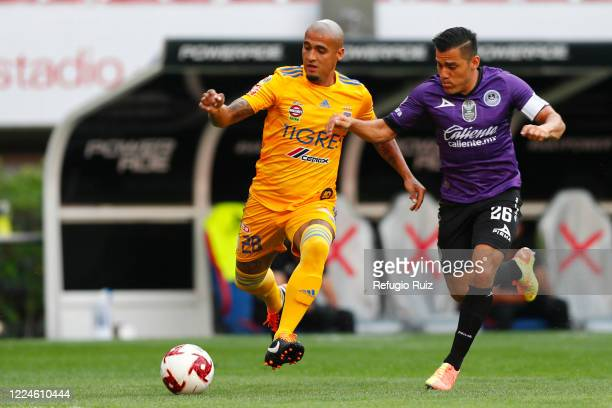 Luis Rodríguez of Tigres fights for the ball with Paul Rocha of Mazatlan during the match between Mazatlan FC and Tigres UANL as part of friendly...